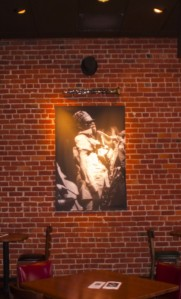 Kathy Sloane's silver gelatin photo of the spiritual force guiding the cafe:  Rahsaan Roland Kirk  immediately beneath his legendary stritch saxophone and top hat.