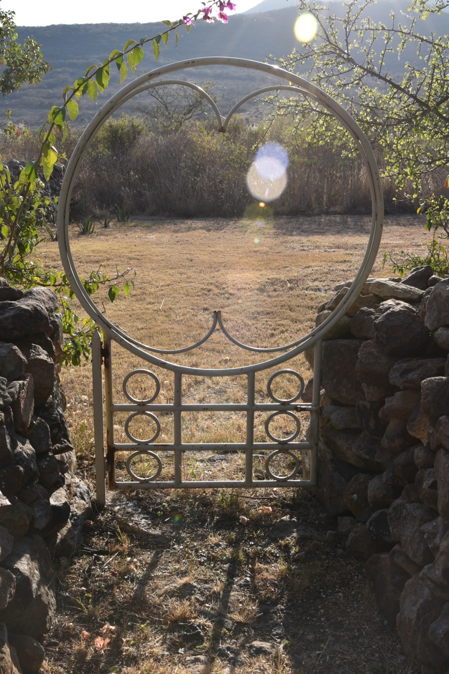 The gate is on the front wall of the property, looking westward to the mountain behind which the sun sets each evening.